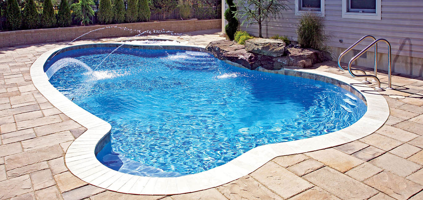 Swimming pool builders environmental view for In ground pool companies